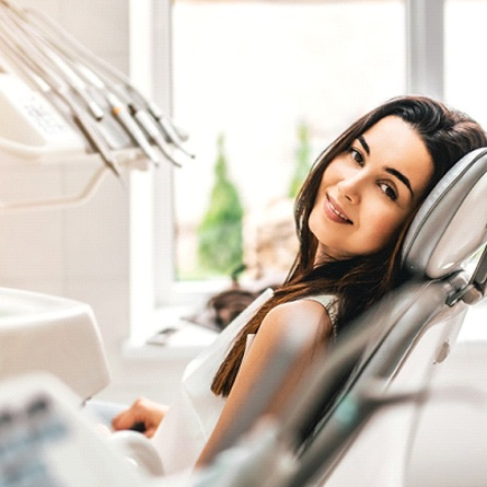 A female patient waiting in the dentist's chair for her appointment to begin