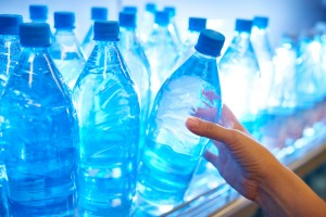What does my family dentist in Helotes think about bottled water?