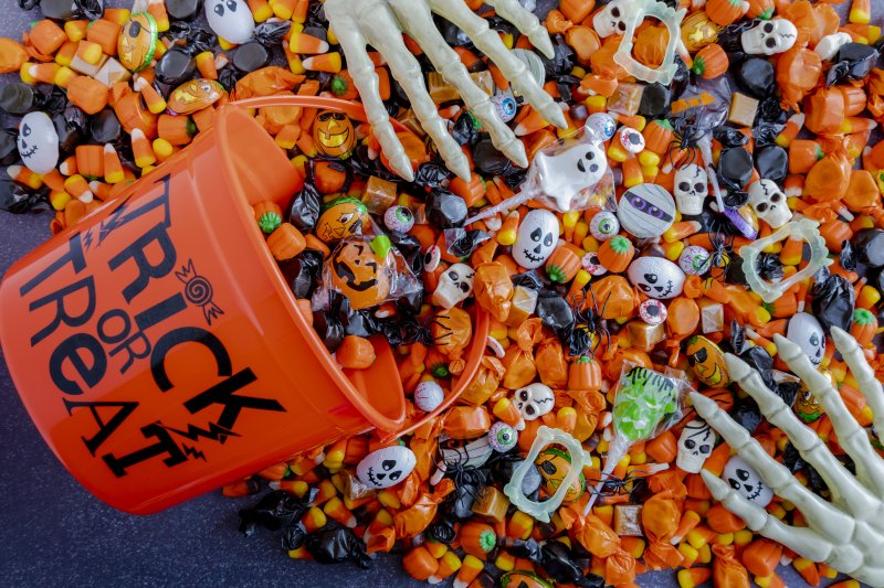 a Halloween bucket dumping out various candies and toys